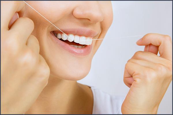 can flossing create gaps in teeth?