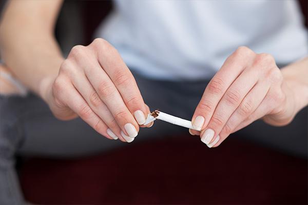 quit smoking as it contributes to skin aging