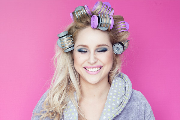 use heated rollers for a quick hair volume boost