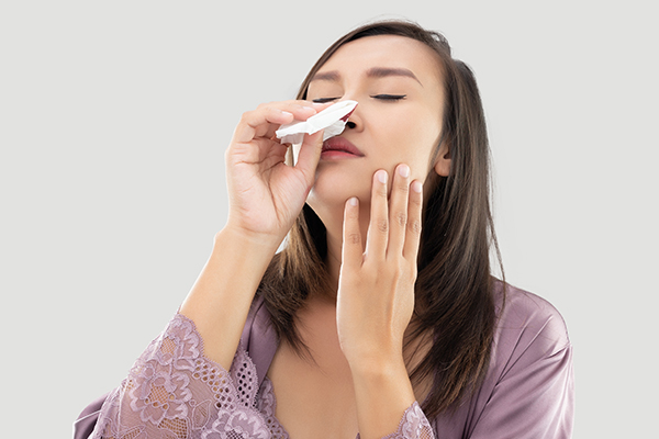 first aid tips to stop a nosebleed at home