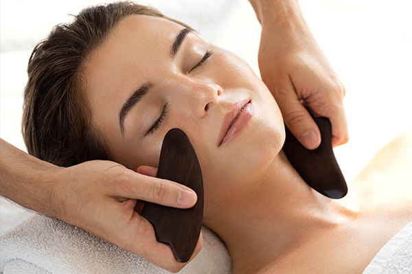try Gua sha therapy to reduce skin inflammation