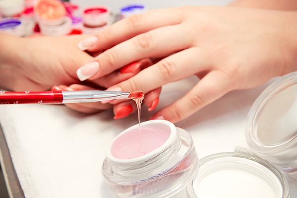 is it safe to wear artificial nails?