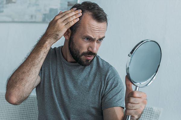 consult a doctor for resolving issues with hair growth