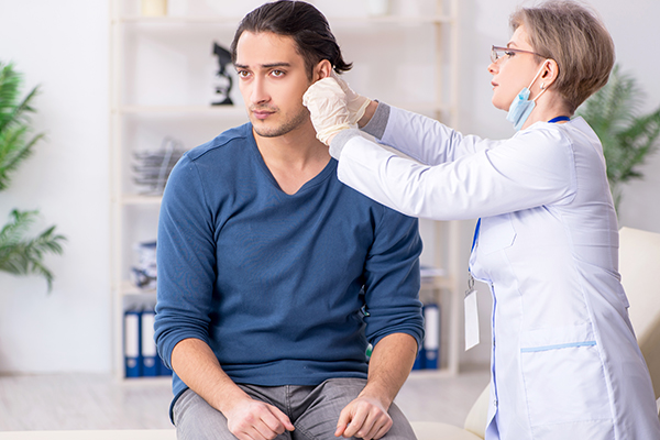 diagnosis of pimples in ear