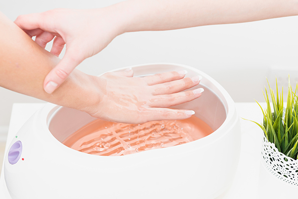 paraffin wax can help manage wrinkled hands
